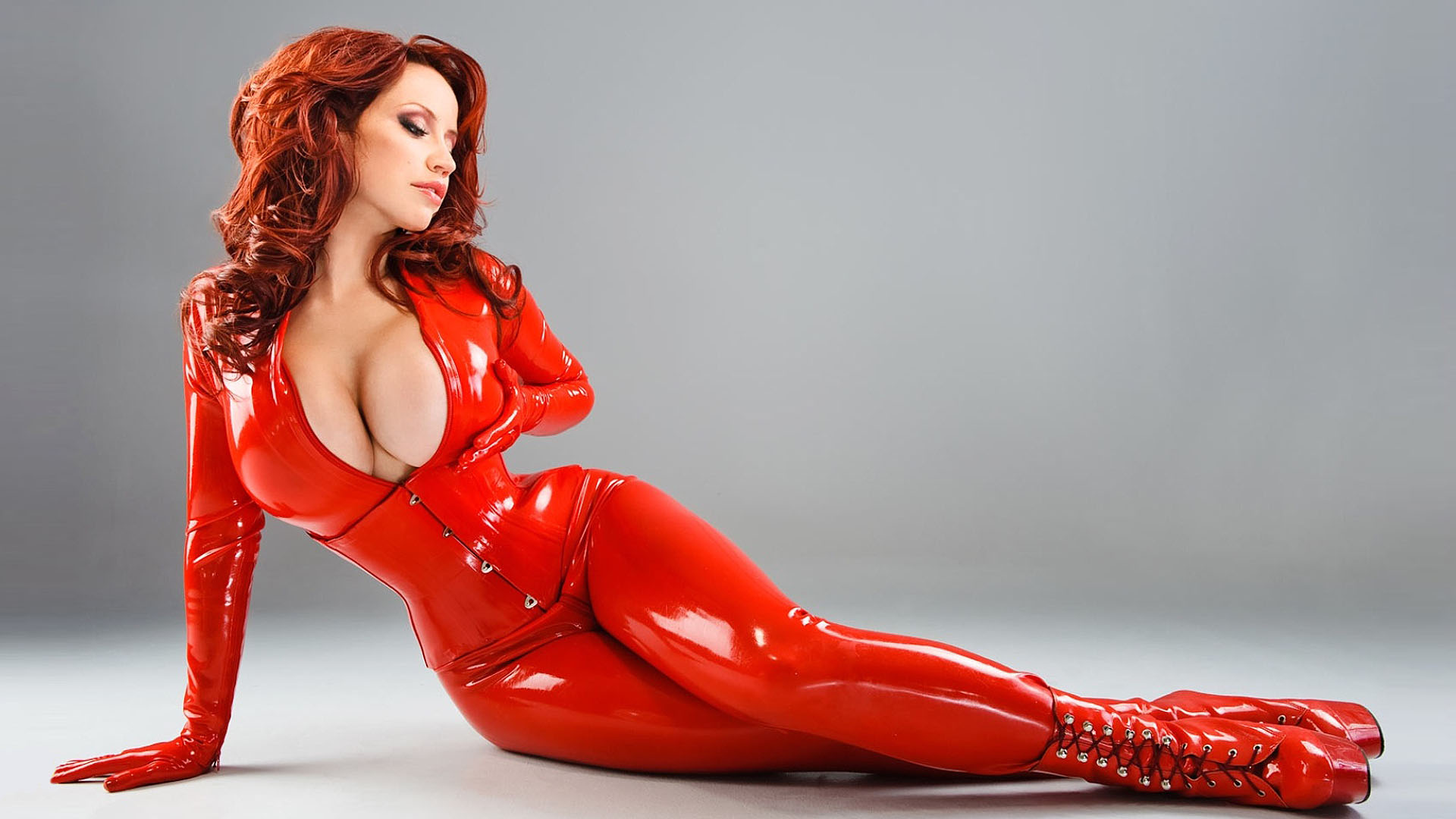 Doll in latex catsuit and female mask have some fun 8
